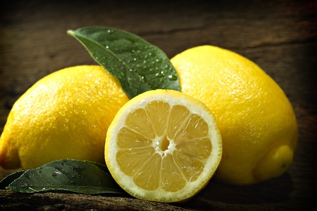 Lemons with a sheet before dark background Stock Photo