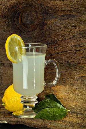 Lemon tea in a glass with lemon slice Stock Photo