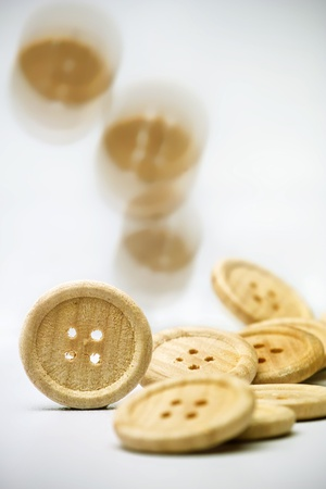 Buttons standing, recumbent and falling before bright background Stock Photo