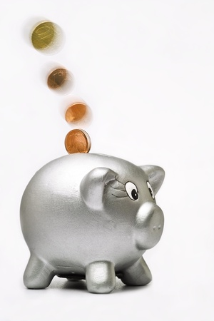 coins are falling in the piggy bank