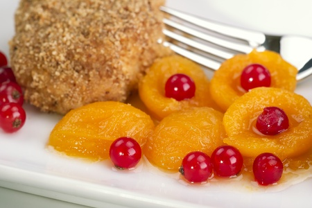 Cream cheese dumpling with apricot compote and currants
