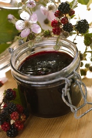 freshly made Blackberry jelly with fresh fruits and Blackberry blossoms