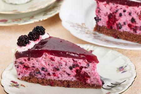 A piece blackberry cake on a nostalgic dessert plate
