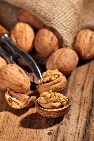 Several walnuts on a wooden board