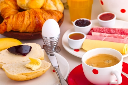 continental breakfast with coffee, cheese,jelly,bread rolls