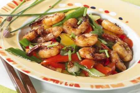 Caramelized shrimps with spring onions and paprika