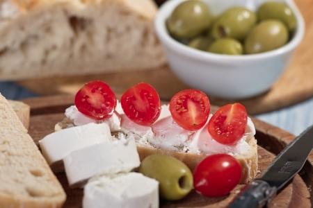 Little cream cheese role on white bread discs