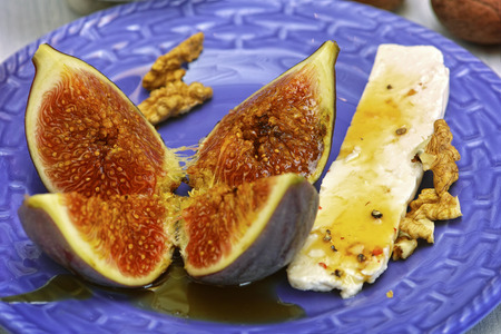 Fresh figs and goat cheese on a plate   Stock Photo