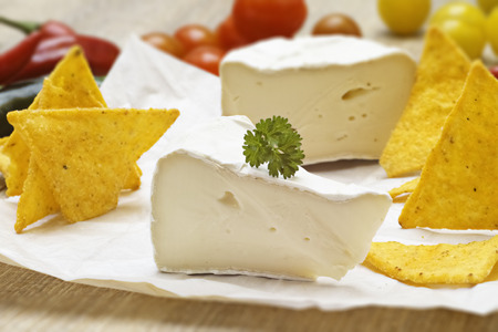 Soft cheese with tomatoes and cracker Stock Photo