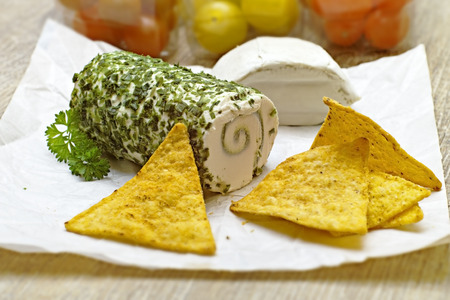 Herb cheese and cracker on paper Stock Photo