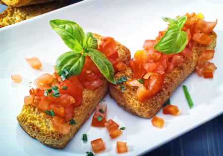 bruschetta: Bruschetta appetizers on a platter Stock Photo
