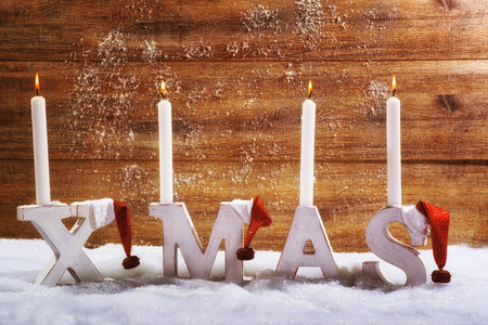 stocking cap: Four burning candles on the letter XMAS