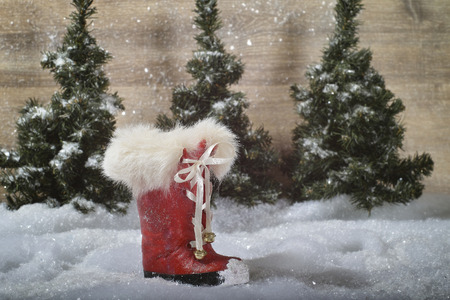 Red boots before Christmas backdrop