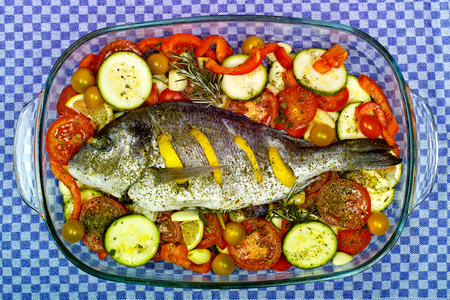 Sea bream Tuscan style with tomatoes and courgettes