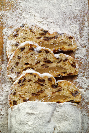 3 pieces of Christmas stollen on a wooden board