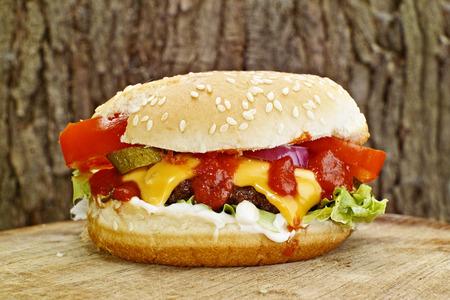 Hamburger with cheese and salad
