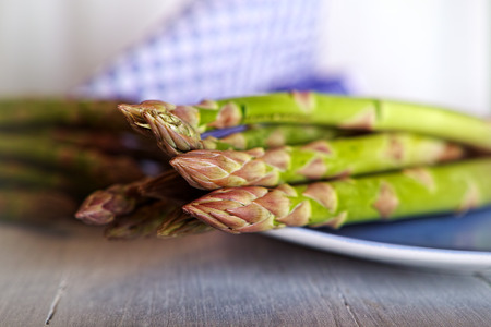 green asparagus on a blue plate