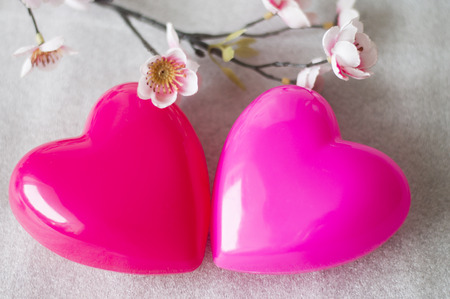 tender sentiment: Two lovers heart close-up Stock Photo