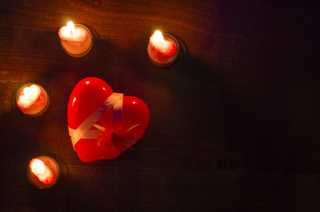 tender sentiment: Composition with candles and hearts