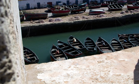 Small fishing boats located in and outside of sea photo