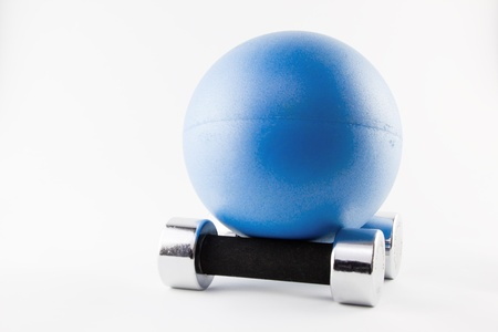 hand weight: Blues Fitness ball position on two silver hand weights Stock Photo