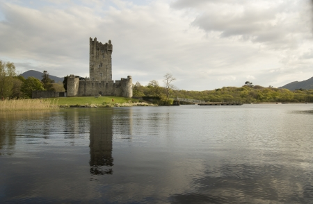 lough: Ross castle and his reflection in Lough  lake. Castle is located near city of Killarney in Ireland.