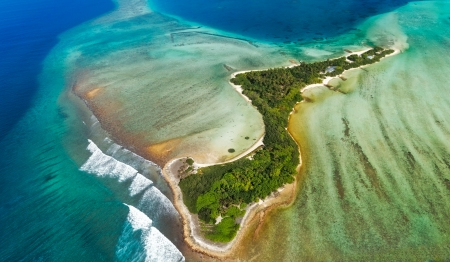 Overview from air over  one of isolated island in Maldives region  Island is in shape of heart photo