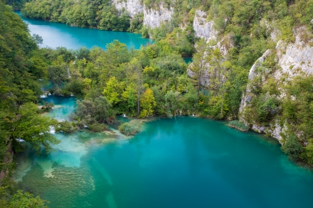 wilderness area: Green lake between big canyon located in Plitvice National Park