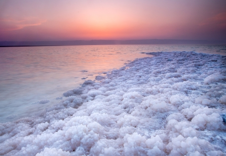 Strong and big salt crystal located on coast of Dead Sea, Jordan photo