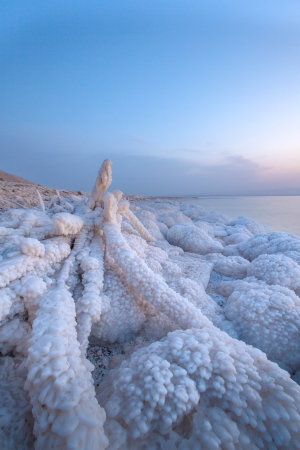 Dead sea with rock of salt in sunset scenary photo