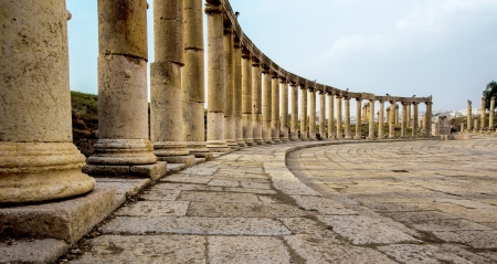 antiquities: Romand and Ancient Greek typical columns in Rome City of Jerash in Jordan. Columns are offset on the lef side of photo Stock Photo
