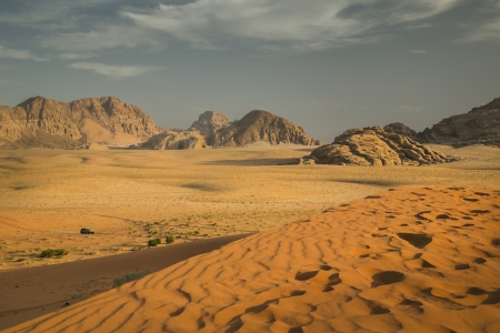 Wadi: Landscape picture of Wadi Rum desert in time of sunset  Wadi Rum is desert located in country Jordan