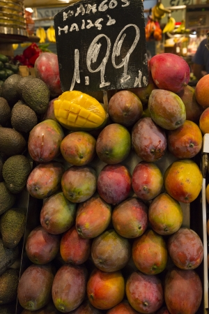 Picture of Mango Fruit in vertical form, with price label on top. Picture taken in Barcelona, Spain photo