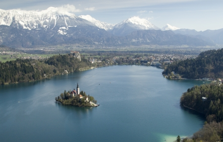 Picture of  Bled Lake and church taken from air view. On picture is whole lake and forrest around lake photo
