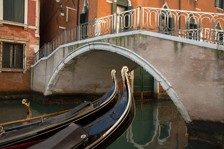bridge over water: Venice building and typical bridge over water chanell with gondola boat details