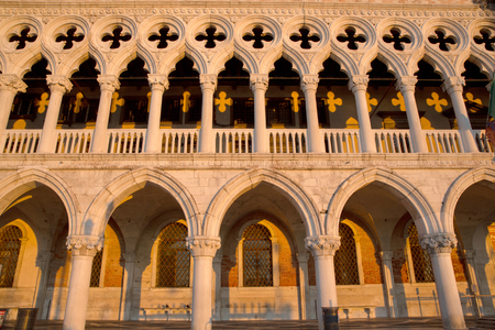 dodge: View of famous Dodge Palace  in perfect sunrise light which is creating  yellow shadow pattern, Venice Italy Editorial