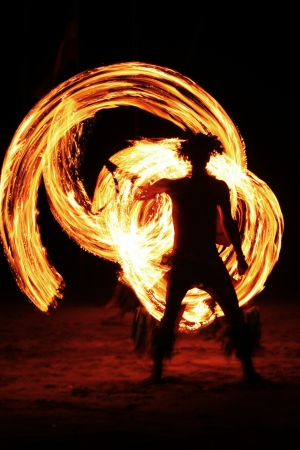 Night fire show on the beach