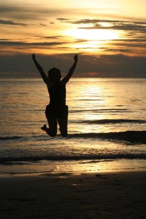 Sea happiness on holidays - sunset Stock Photo