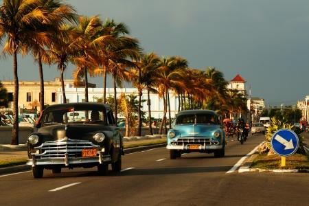 Old cuban cars on avenue