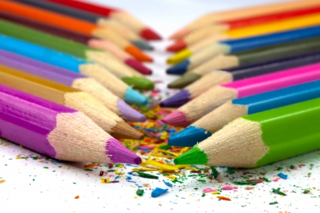 Colorful pencils with shawings between them.