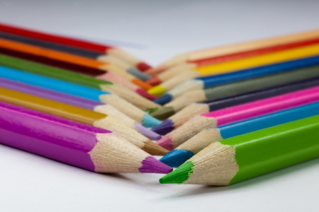 Colorful pencils being crossed.
