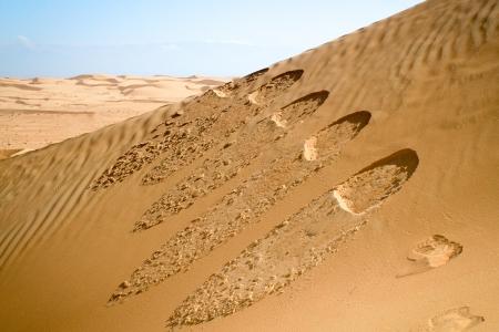 Foot steps in Desert, near Muscat, Oman Stock Photo