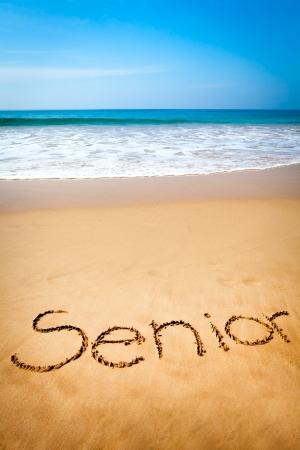 Word Senior Written in Sand, Tropical Beach
