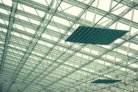 Modern glass roof and steel columns - pillars