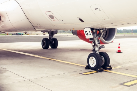 Landing gear and undercarriage of a jet airplane parked