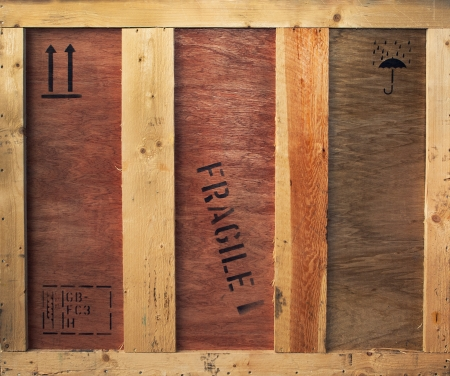 Wooden box with fragile and freight signs on it