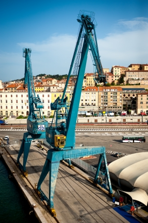 ANCONA, ITALY - MAY 3: Huge crane in Ancona Port, Italy, on May 3, 2013. Since the beginning of recession, the annual traffic slightly falls - in 2012 to abou 8 millions tons.