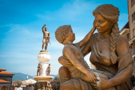 Statue of mother & son and statue of Alexander the Great in background, in center of Skopje (downtown), Macedonia (FYROM) Stock Photo