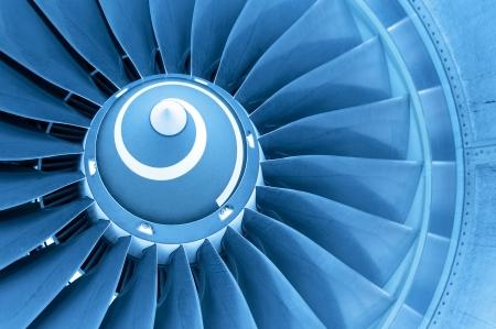 Titan blades of jet plane engine in blue light