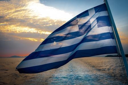Greek Flag on boat in wind, dramatic sky